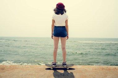 girl in shorts riding Skateboard