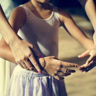 ballerina teacher practice with girl