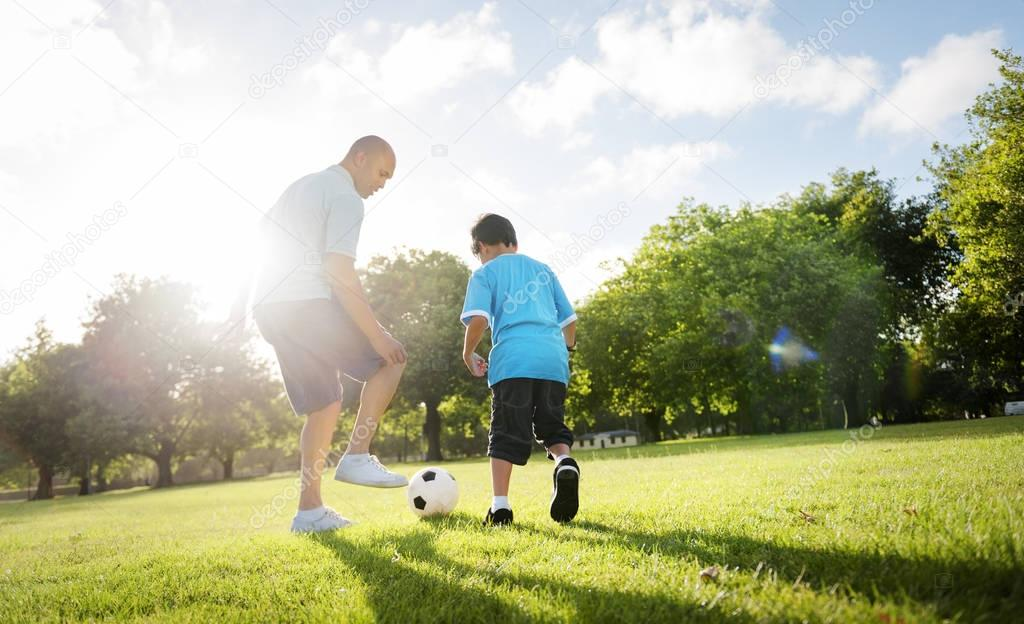 Father with son play Football