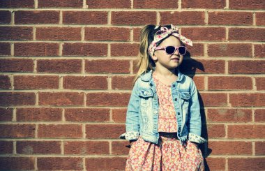 Fashionista Girl against brick wall