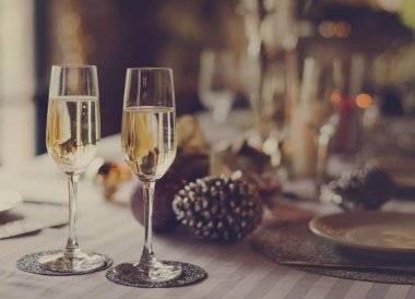 Champagne glasses on served table