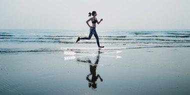 sportive woman Running on Beach