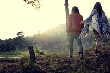 Young Couple of Travelers in Forest