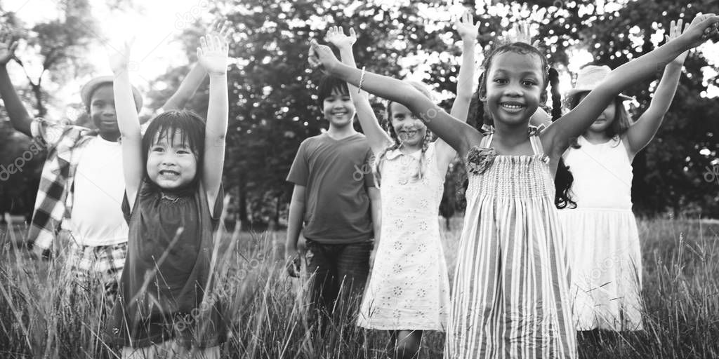 Multi ethnic children playing outdoors