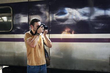 Man with Camera at railway station