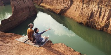 Couple sitting at lake