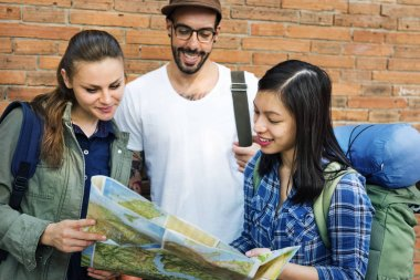 Young Friends Travelers with Map