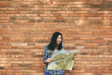 Woman holding map