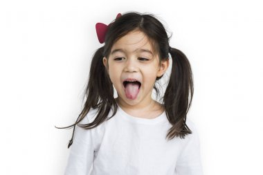 Cute little girl showing tongue