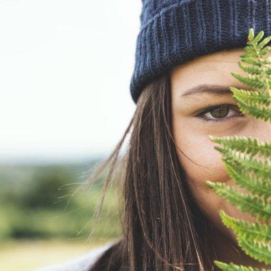 Woman with fern leaf