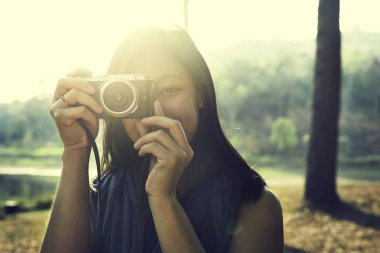 Woman Photographer Holding Camera