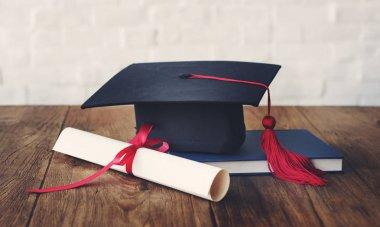 diploma and Master's cap