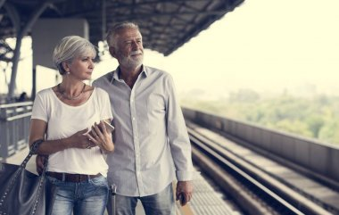 couple walking on train station