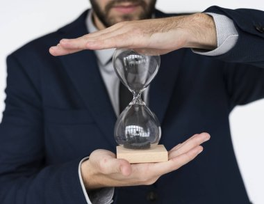 Man holding hour glass