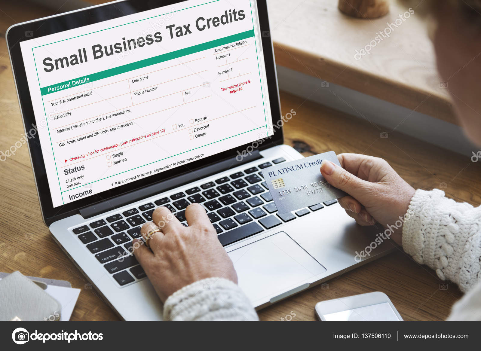 Person holding credit card stock photo rawpixel 137506110 person holding credit card internet online banking and online purchase concept text on scree small business tax credits photo by rawpixel reheart Images