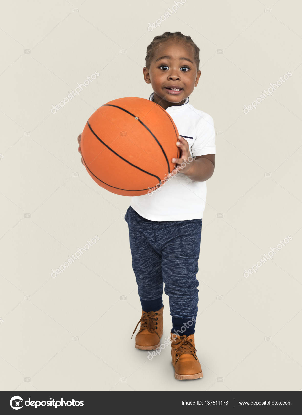 african boy holding basketball ball stock photo rawpixel 137511178