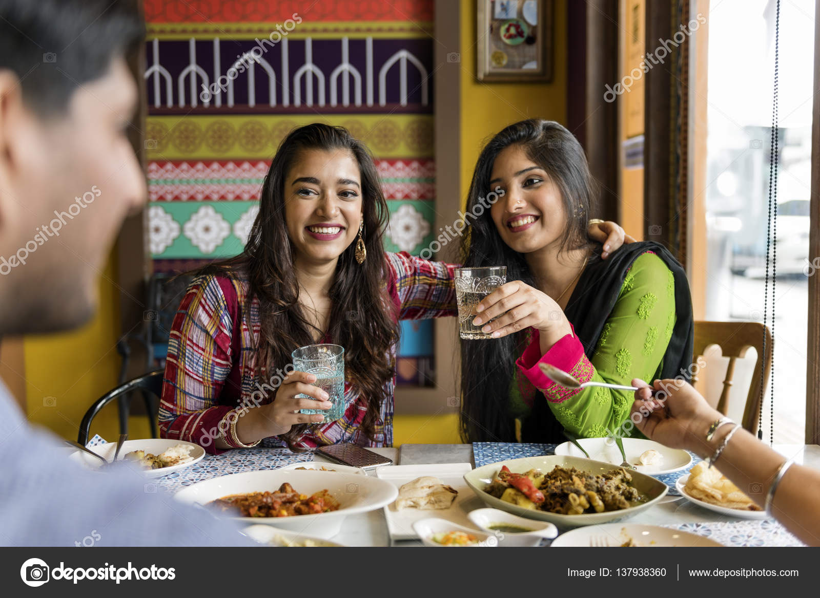 People Eating Indian Food In Restaurant Stock Photo Rawpixel