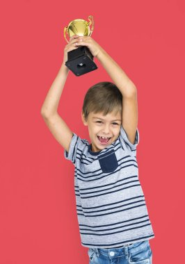 Boy holding Winning Cup