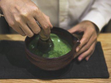 person preparing Japanese Matcha