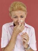 Senior Woman Blowing Nose