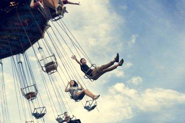 happy friends in Amusement Park
