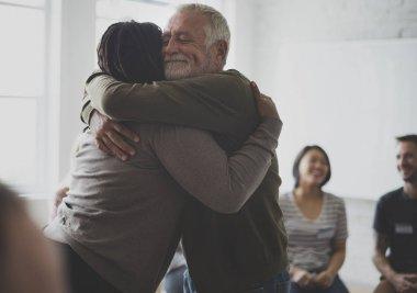 man hugging woman
