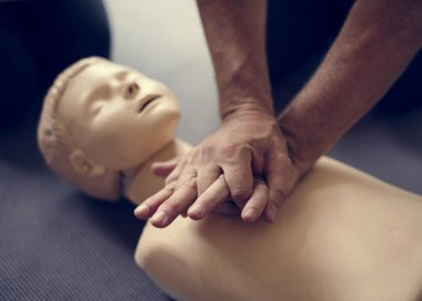 Person learning CPR First Aid Training