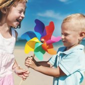Children playing with blowing flower