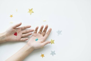 human hands with celebration confetti