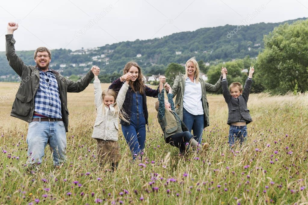 Family Walking in Field