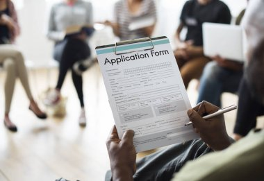 Person filling application form