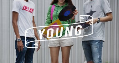 stylish Teenagers with vinyl record