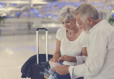 Couple sitting in airport terminal
