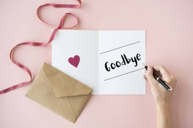 human hands writing on greeting card