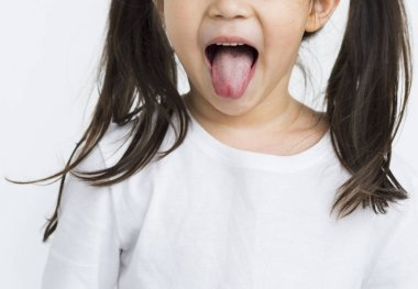 l girl showing tongue