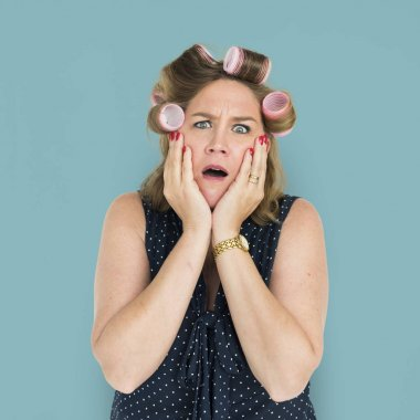 Shocked Woman with hair curlers.