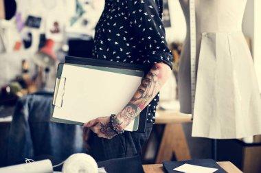 Fashion Designer holding folder