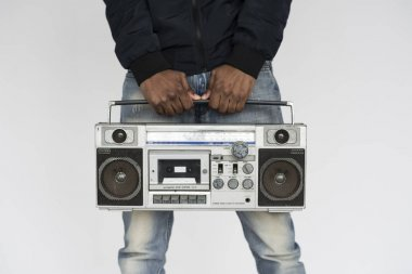 African man listening music in boombox