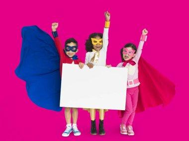 children holding banner