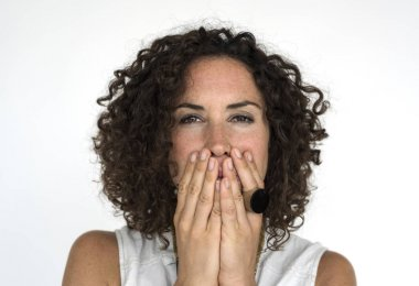brunette woman covering mouth