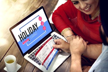 couple buying tickets online