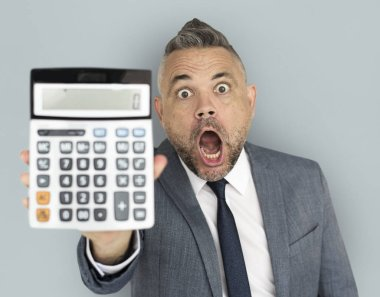 shocked businessman showing calculator