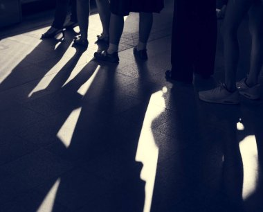 crowd legs and shadows