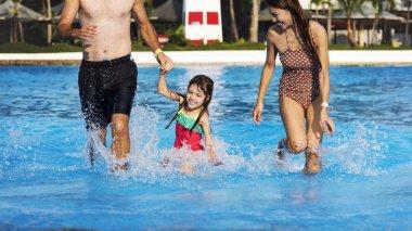 girl having fun in swimming pool