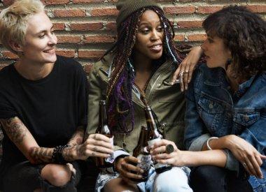 Diversity women Celebrating with Beer