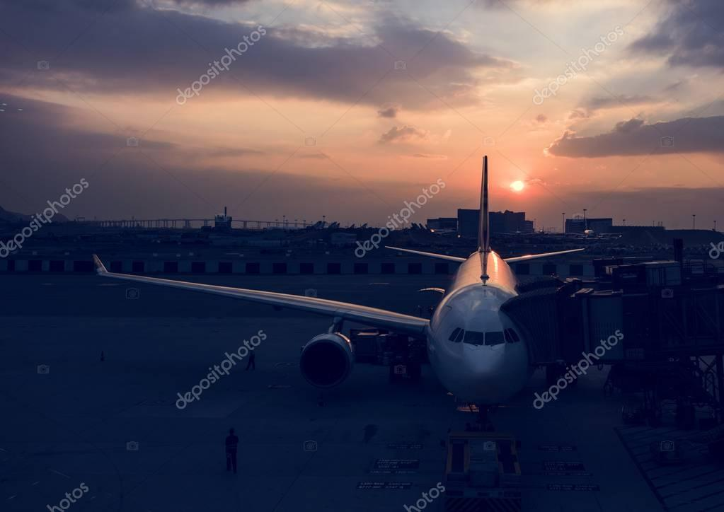 Airplane in Airport with sunset