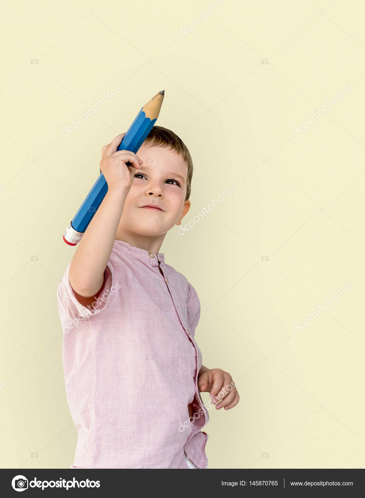 Boy drawing with pencil stock image