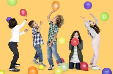 group of children playing with colorful balloons