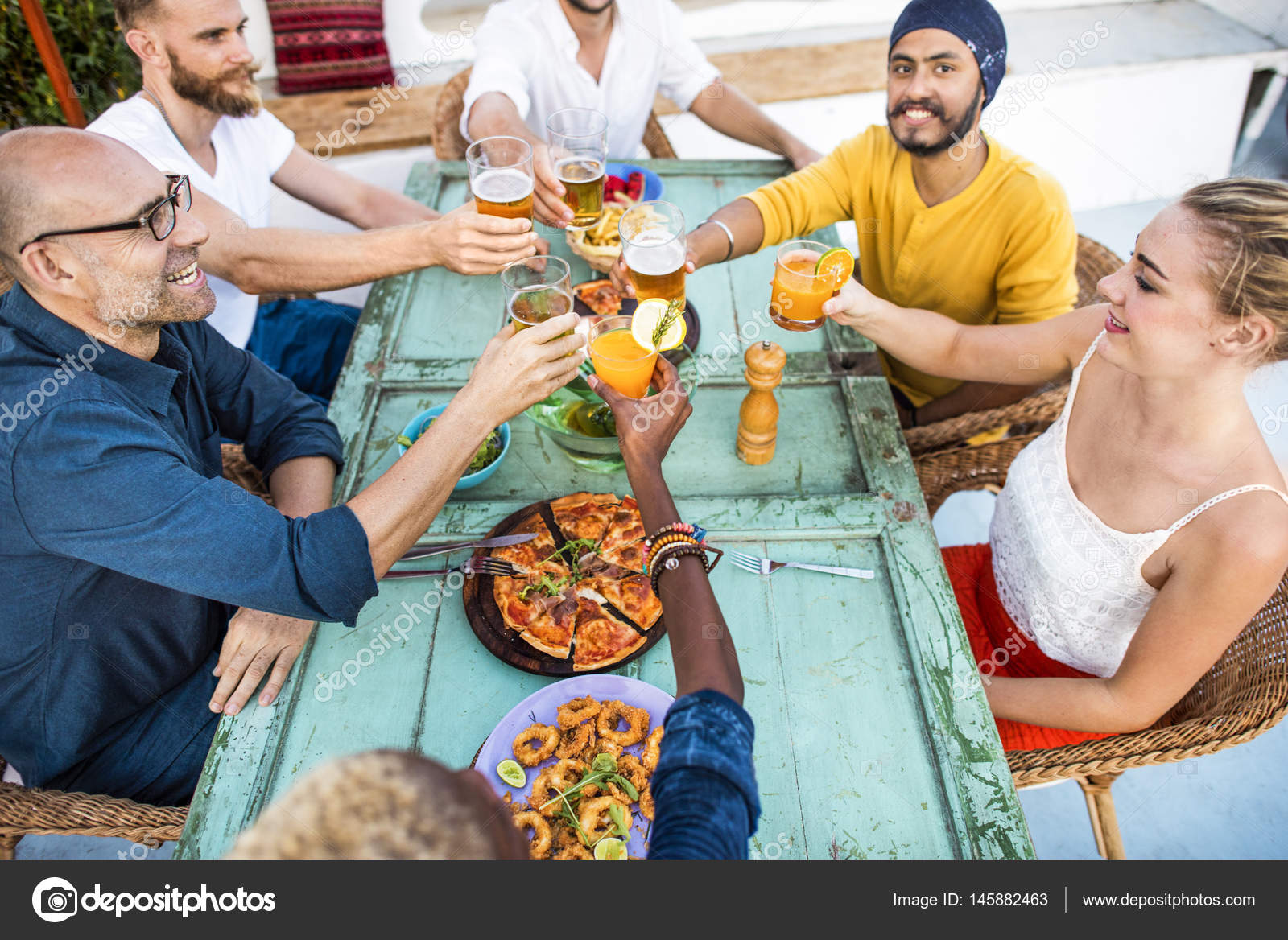 People Eating And Drinking On Picnic