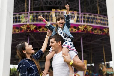 Family having fun in amusement park